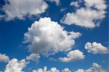 fluffy - Storm clouds in a blue sky Stock Photo - Premium Royalty-Free, Code: 6106-06401542