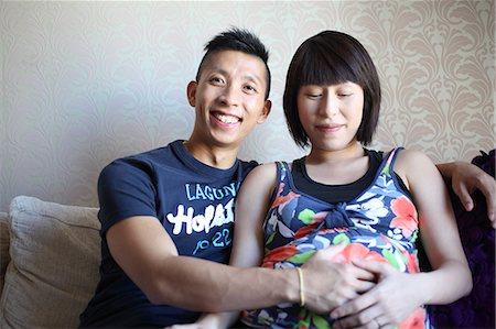 pregnant asian - Happy Asian expectant couple Stock Photo - Premium Royalty-Free, Code: 6106-06401617