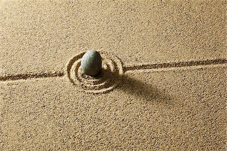 Zen stone on sand Stock Photo - Premium Royalty-Free, Code: 6106-06401757