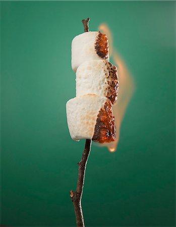 stick - Roasting Marshmallows on a Stick Stock Photo - Premium Royalty-Free, Code: 6106-06401968