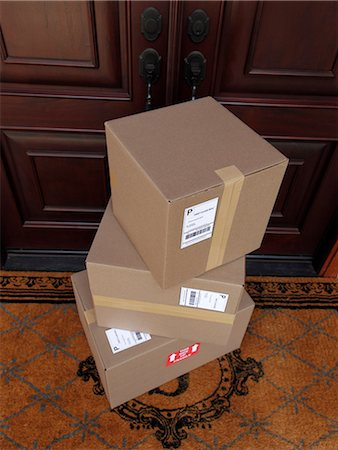 Down view of packages stacked by double doors Stock Photo - Premium Royalty-Free, Code: 6106-06402135