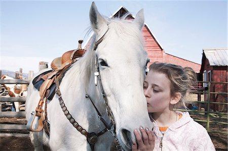 preteen kissing - Josey and Gray Horse, Ellensburg WA Stock Photo - Premium Royalty-Free, Code: 6106-06434224