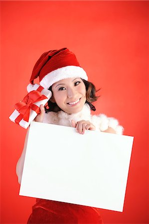 fur - Beautiful Christmas Girl Holding a Blank Signage Stock Photo - Premium Royalty-Free, Code: 6106-06434409