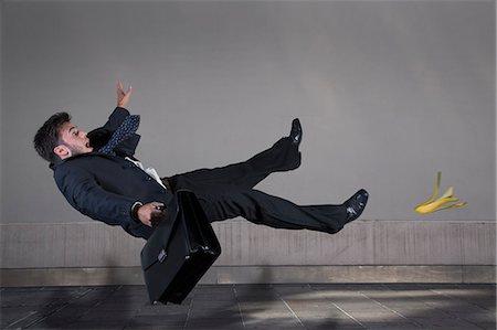 people falling - Businessman slipping on a banana peel Stock Photo - Premium Royalty-Free, Code: 6106-06434420