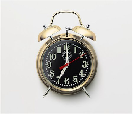 Gold alarm clock on white background Stock Photo - Premium Royalty-Free, Code: 6106-06434519