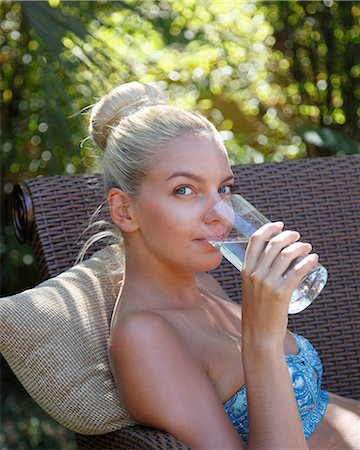 drinking water glass - Young lady drinking water closeup Stock Photo - Premium Royalty-Free, Code: 6106-06434755