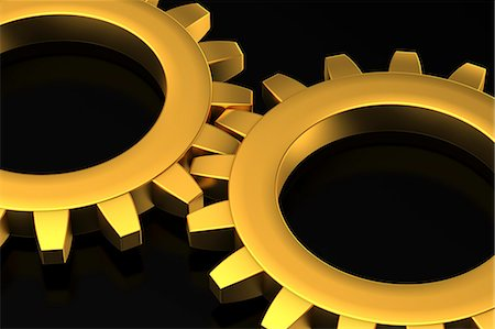 Two Golden Cog Wheels Stock Photo - Premium Royalty-Free, Code: 6106-06434852