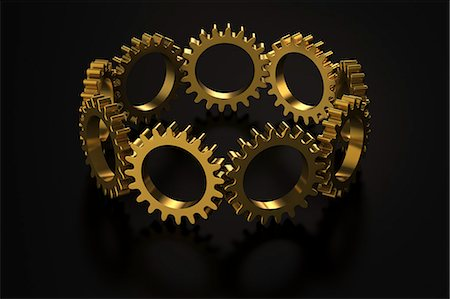 Golden cogwheels on black reflective background Stock Photo - Premium Royalty-Free, Code: 6106-06434881
