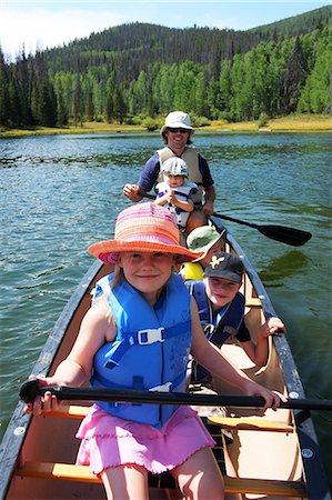 recreation - Family canoeing on lake in mountains Stock Photo - Premium Royalty-Free, Code: 6106-06535252