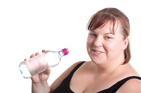 Overweight Woman Drinking Water Stock Photo - Premium Royalty-Free, Code: 6106-06535546