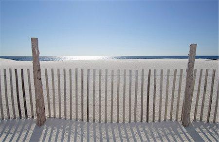 Sand Fence On Beach Stock Photo - Premium Royalty-Free, Code: 6106-06536201