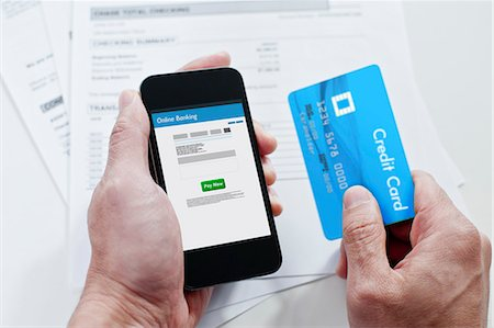 person on phone with credit card - Mobile online banking Stock Photo - Premium Royalty-Free, Code: 6106-06536458