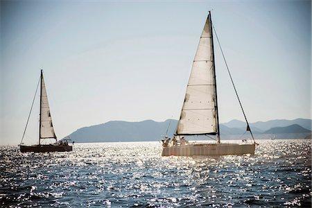 sailboat  ocean - Two sailboats sailing, Turkey Stock Photo - Premium Royalty-Free, Code: 6106-06536466