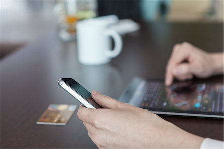person on phone with credit card - online shopping with tablet PC and credit card Stock Photo - Premium Royalty-Free, Code: 6106-06614443