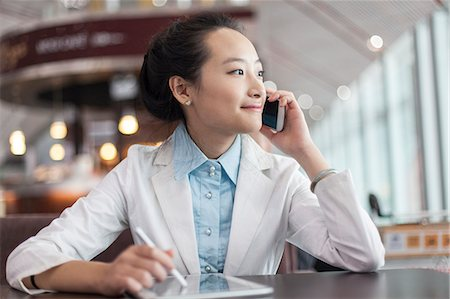 businesswoman with digital tablet Stock Photo - Premium Royalty-Free, Code: 6106-06614517