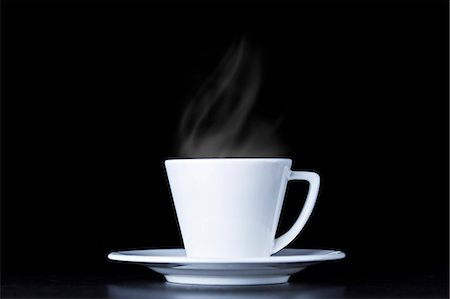 White coffee cup and steam on black background Stock Photo - Premium Royalty-Free, Code: 6106-06614532