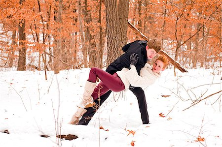 Two young friends having fun together in the snow. Stock Photo - Premium Royalty-Free, Code: 6106-06614767