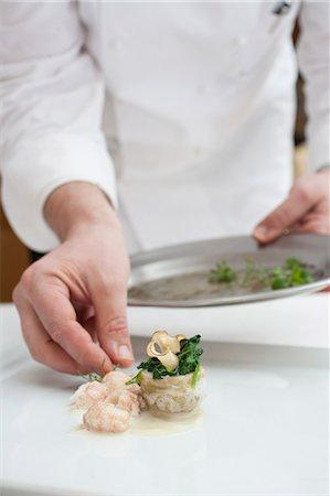 Chef preparing dish Stock Photo - Premium Royalty-Free, Code: 6106-06614928