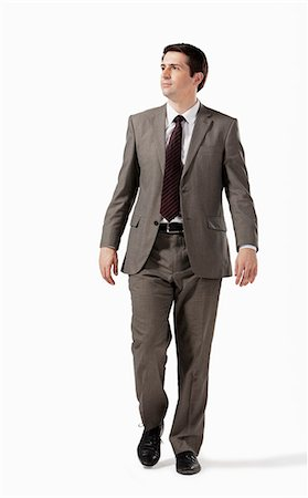 Business man strolling along Stock Photo - Premium Royalty-Free, Code: 6106-06830258