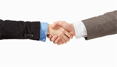 Business man and woman shaking hands Stock Photo - Premium Royalty-Free, Code: 6106-06830312
