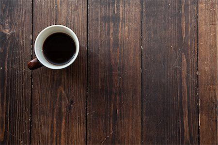 floor - Coffee in a mug on a wooden floor Stock Photo - Premium Royalty-Free, Code: 6106-06830829