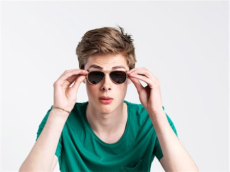 Young man wearing sunglasses Stock Photo - Premium Royalty-Free, Code: 6106-06830977