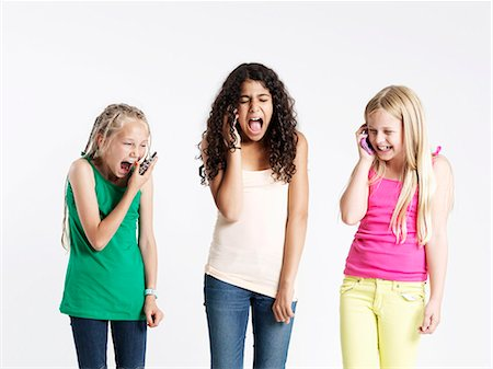preteen open mouth - Three girls using smart phones Stock Photo - Premium Royalty-Free, Code: 6106-06830984