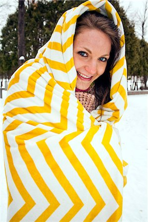 Portrait of a young girl outside in the snow. Stock Photo - Premium Royalty-Free, Code: 6106-06831145