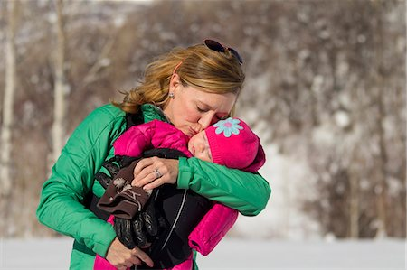 Mother with baby daughter snowshoeing Stock Photo - Premium Royalty-Free, Code: 6106-06831173