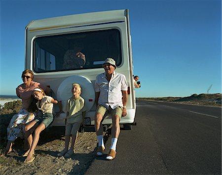 preteen thong - Three generational family pushing broken-down campervan at roadside Stock Photo - Premium Royalty-Free, Code: 6106-06977868