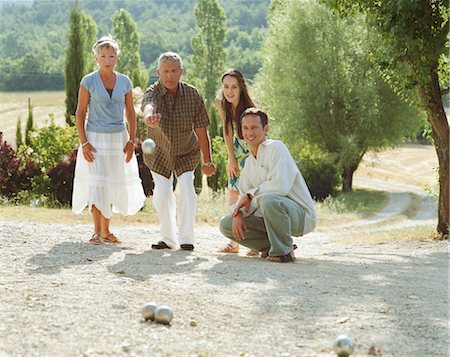 Two couples playing boule Stock Photo - Premium Royalty-Free, Code: 6106-06978789