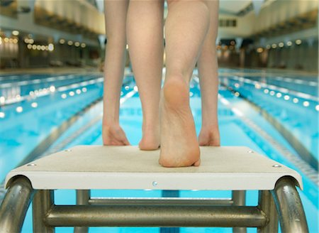 preteen girl feet - Girl (10-12) preparing to jump of diving board, low section Stock Photo - Premium Royalty-Free, Code: 6106-06979908