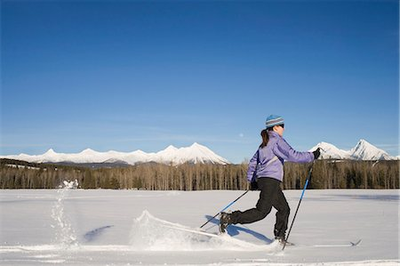 Woman cross country skiing, side view, winter, moonrise Stock Photo - Premium Royalty-Free, Code: 6106-06980361
