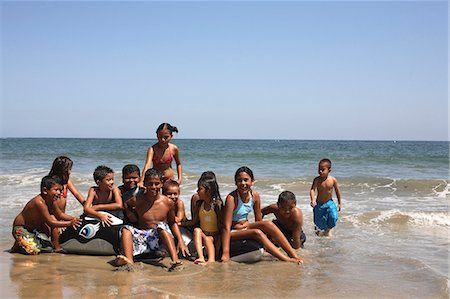 preteen girl wet clothes - Children (4-10) on beach playing in sea Stock Photo - Premium Royalty-Free, Code: 6106-06984647