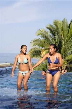 Teenage girls (15-17) standing in swimming pool Stock Photo - Premium Royalty-Free, Code: 6106-06984695