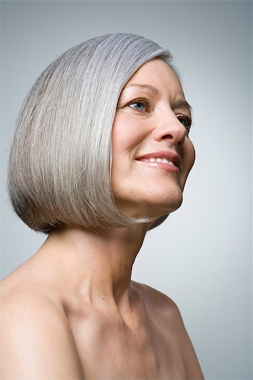 Mature woman smiling, close-up Stock Photo - Premium Royalty-Free, Image code: 6106-06990229