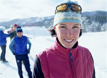 Group of people cross-country skiing (focus on woman in foreground) Stock Photo - Premium Royalty-Free, Code: 6106-06992612