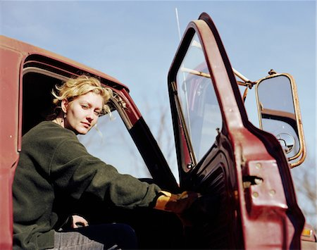 female truck driver - Young woman sitting in truck with the door open, portrait Stock Photo - Premium Royalty-Free, Code: 6106-06992937