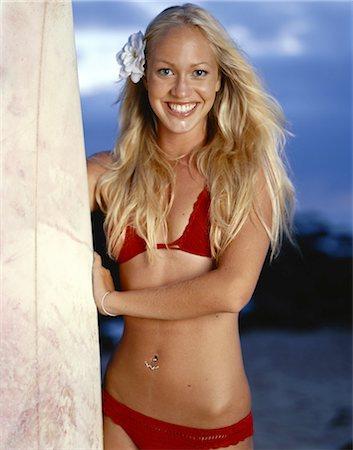 Teenage Girl with Surfboard Stock Photo - Premium Royalty-Free, Code: 6106-06993690