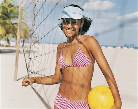 Portrait of a Teenage Girl on a Beach Holding a Ball Stock Photo - Premium Royalty-Free, Code: 6106-06995854