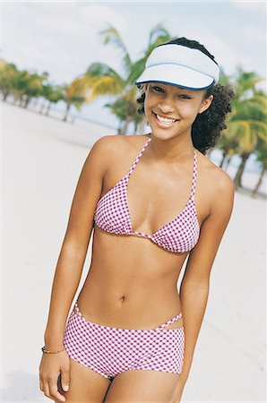 Portrait of a Teenage Woman on a Beach Stock Photo - Premium Royalty-Free, Code: 6106-06995855