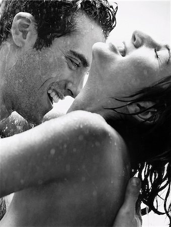 Nude Couple Smiling Under the Shower Stock Photo - Premium Royalty-Free, Code: 6106-06995987