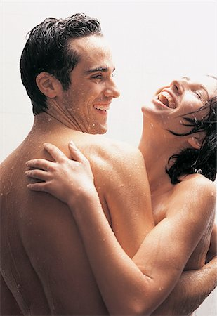 Couple With Their Arms Around Each Other Standing Nude Under the Shower Stock Photo - Premium Royalty-Free, Code: 6106-06995984