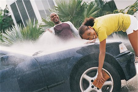 preteen girl wet clothes - Father and Daughter Cleaning a Car Stock Photo - Premium Royalty-Free, Code: 6106-06995911