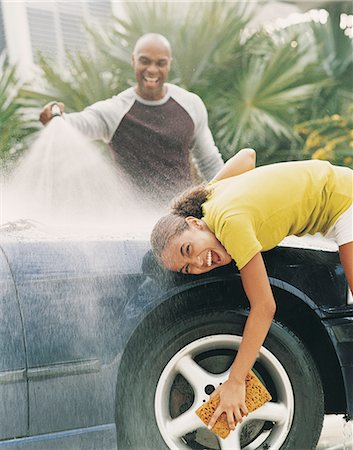 preteen girl wet clothes - Father and Daughter Cleaning a Car Stock Photo - Premium Royalty-Free, Code: 6106-06995912