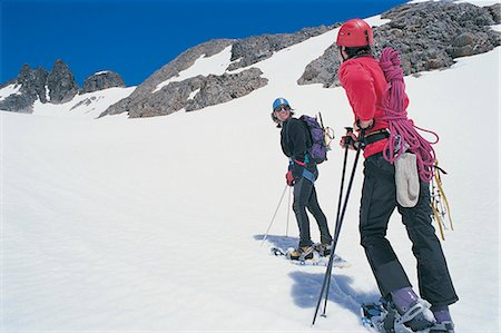 Young Couple Cross Country Skiing Near a Mountain Ridge With Rope and Mountaineering Equipment Stock Photo - Premium Royalty-Free, Code: 6106-06999853
