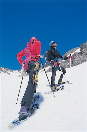 Couple Cross Country Skiing up a Mountain Ridge With Mountaineering Gear Stock Photo - Premium Royalty-Free, Code: 6106-06999856
