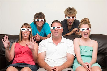 Family 3D Television Stock Photo - Premium Royalty-Free, Code: 6106-07070001