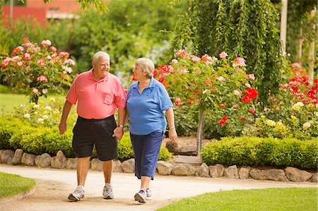 fat man full body - Senior Couple Walking in a Park Stock Photo - Premium Royalty-Free, Code: 6106-07070002