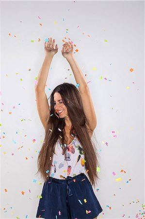 young woman with confetti flying Stock Photo - Premium Royalty-Free, Code: 6106-07070180